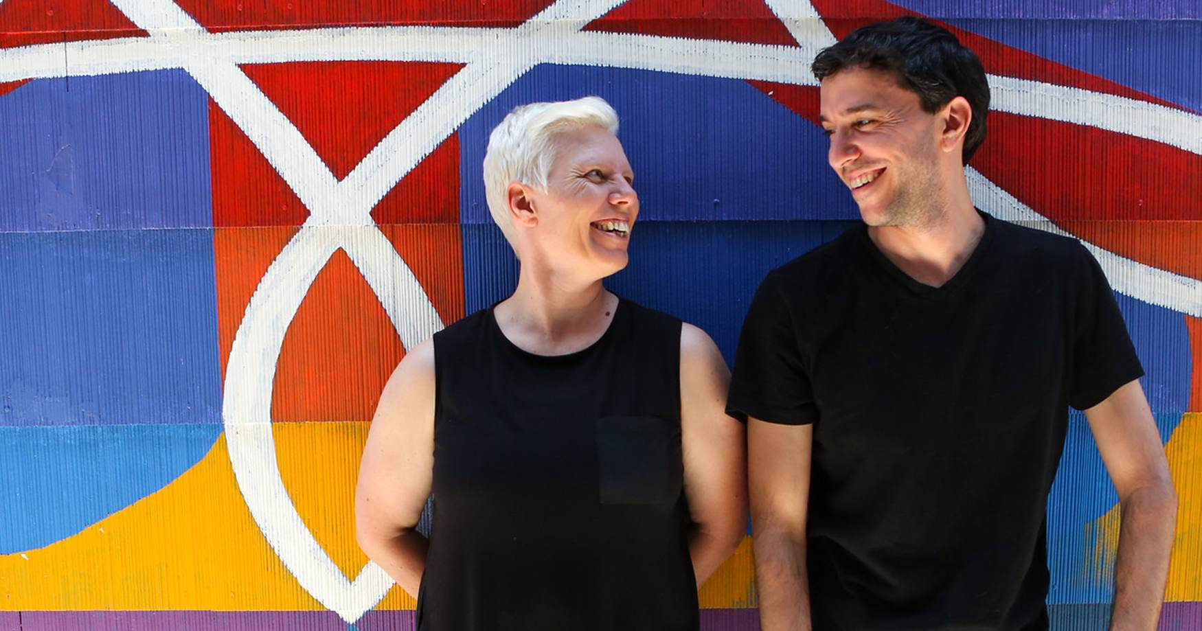 Zara Lawler and Paul Fadoul against a colorful background