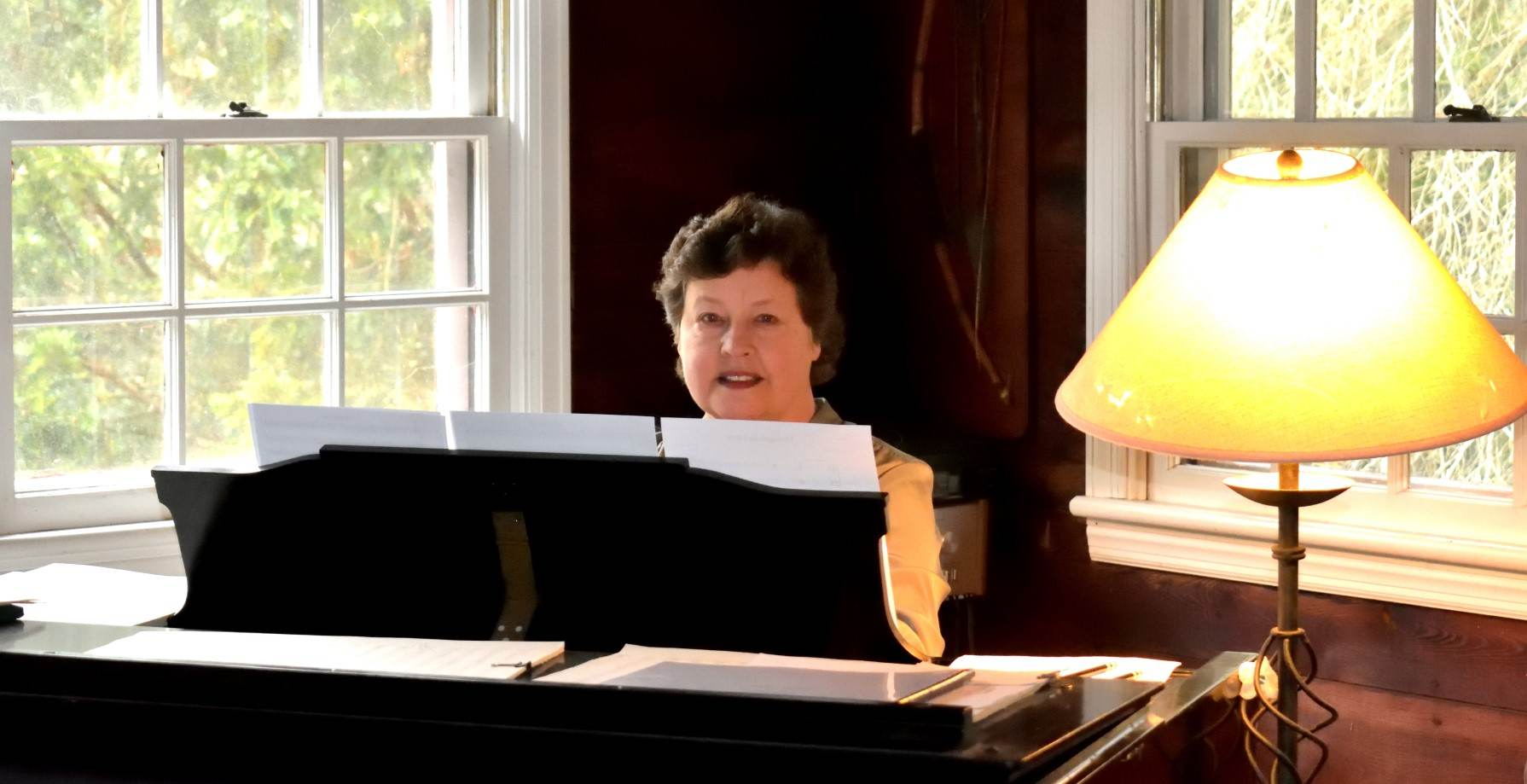 Composer Hilary Tann at the piano