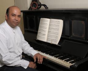 Composer Ganesh Kumar at the piano
