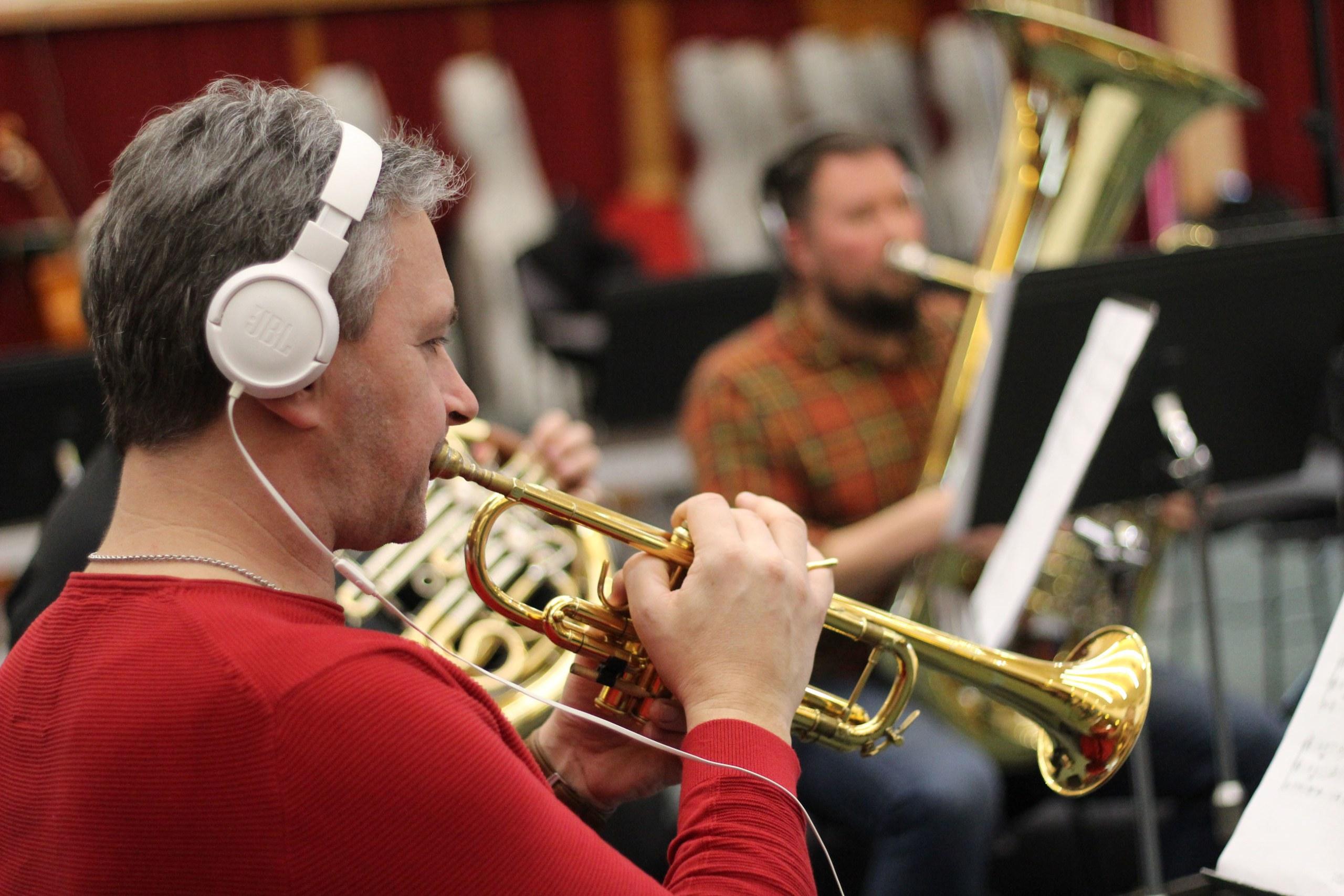 Trumpet player with headphones